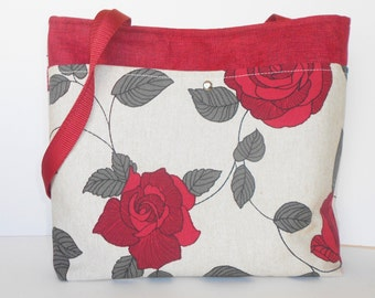 Shoulder bag with modern floral in red and tan for spring.