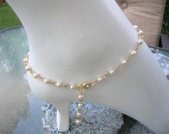 Pearl anklet.