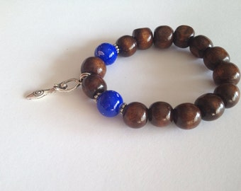 CLEARANCE *** Splendid wood beads bracelet with 2 glass painted sapphire beads and a goddess charm
