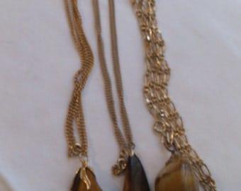 Three vintage tumblestone pendants with chains