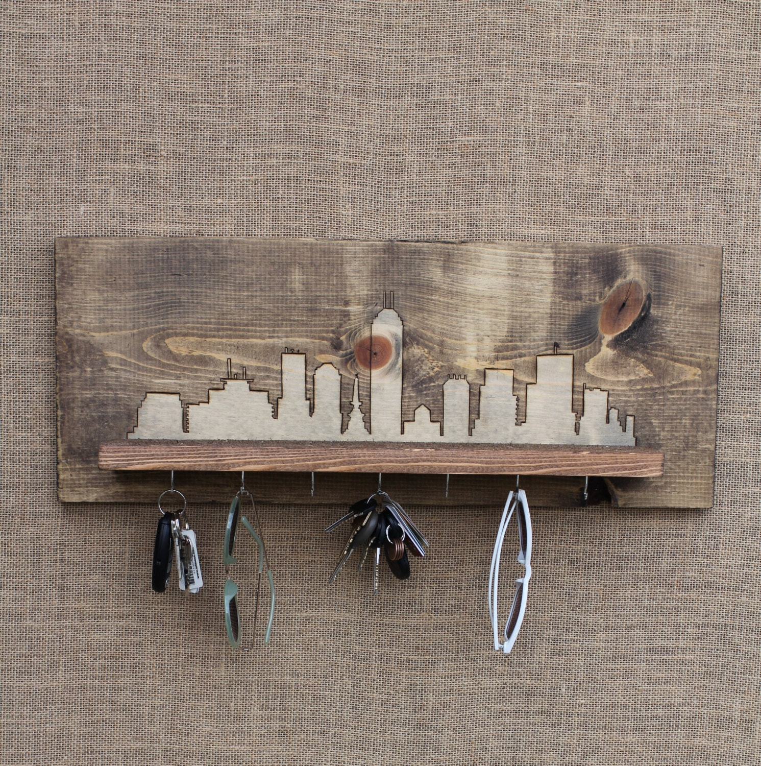 wooden entryway shelf and key holder with wood burned city