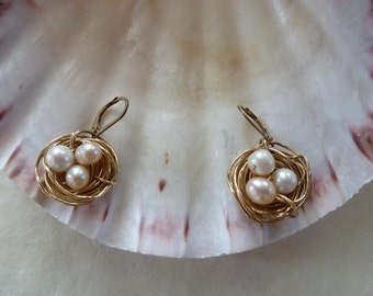 14 kt goldfilled 20 gauge wire 30 inches wound, twisted and tweaked into adorable nests laid with plump pearl eggs on leverback earwires