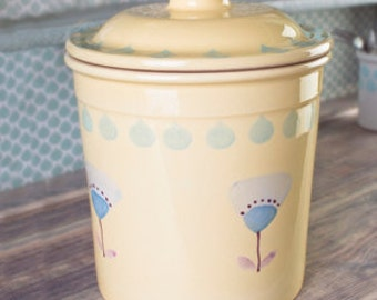 Yellow hand-painted kitchen compost caddy.
