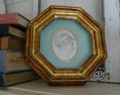 Octagonal shadowbox framed portrait