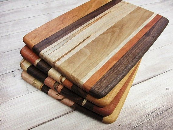 Wood Cutting Board Rectangle Bread Cheese Sushi Pizza Wobble Plate with Handle. Wood chopping board perfect for slicing bread, pizza, sushi, fruits and vegetables. Easy to Clean and Maintain. Just wip Handcrafted wooden cutting board, maple with cherry and walnut 5 3/4 x 10 3/4. $