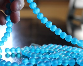 100 approx. 8 mm aqua frosted glass beads, round and smooth, one strand for making jewelry