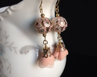 Elegant pastel colored bead with a pink fabric flower earring