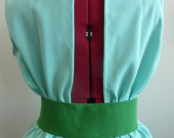 Top with open back in a mint green color