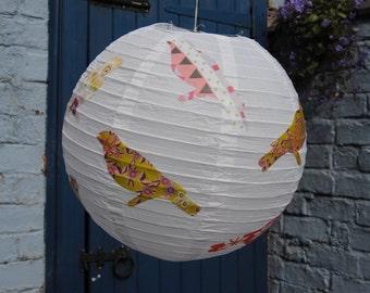 Decoupage garden bird rice paper lantern.