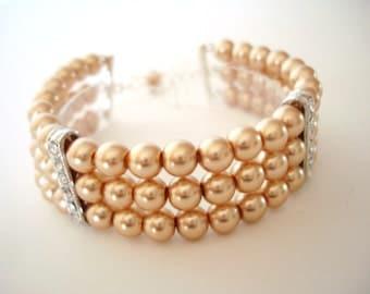 Gold Triple-Strand Pearl Bracelet