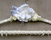 Wedding dress hanger, white, ivory silk flowers, feathers, pearls, crystals, paper flowers, crocheted trim, bride, custom, personalized.