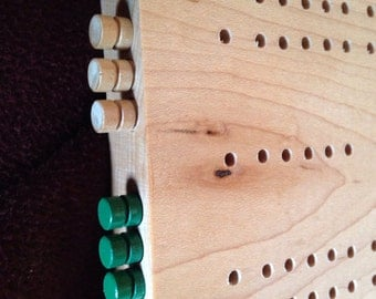 Cribbage board made from solid hard maple, with peg storage in the end. Tournament layout for easy tracking!