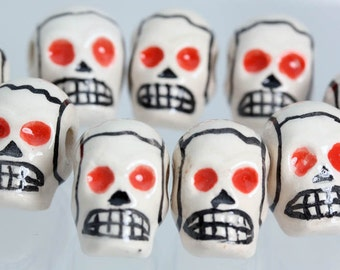 Ceramic Red Eyed Skull beads. Crafts, Jewellery Making Projects x 10