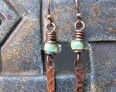 Lamp work earrings with copper pendants