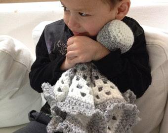 White and gray crochet baby lovie