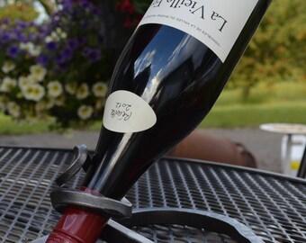 Scroll end wine bottle holder