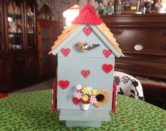 This is my own version of  a bird condo. I made it so birds in the winter time could all get together and stay warm.