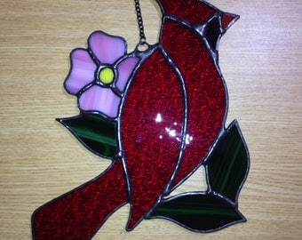 Red cardinal with pink flower stained glass suncatcher
