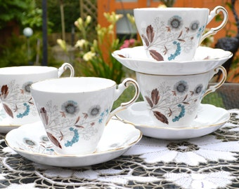 Regency English Bone China Teacup and Saucer - White China, Gilt Rims, Wild Flowers in Tones of Blue and Brown