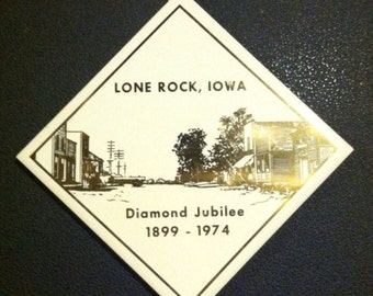 Vintage collectible trivet commemorating the Diamond Jubilee 1899-1974 for Lone Rock, Iowa.