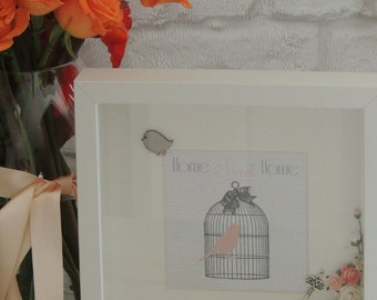 Luxury decorated art print presented in a off white shadow box frame.