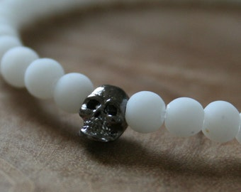 Black and white Skull: an elastic beaded bracelet with gunmetal skull and white glass beads.