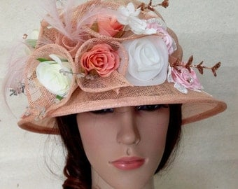 An Apricot Orange Sinamay Bowler Derby Church Flower Hat With  Sinamay Flowers.