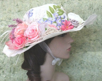 A White Church Hat With Painted Top,Flowers And Feather