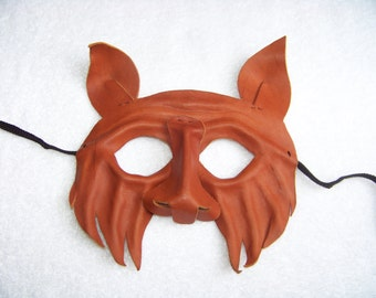 Hand Sculpted Leather Wolf Mask finished with neatsfoot oil.