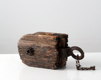 antique pulley,  wood block and iron tackle,  rustic farm tool