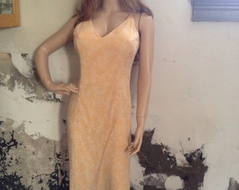 Peach beaded  evening gown
