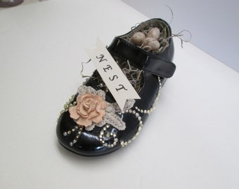 Altered shoe with tiny bird's nest