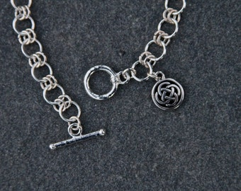 Silver Celtic Bracelet with Enclosed Celtic Knot Charm