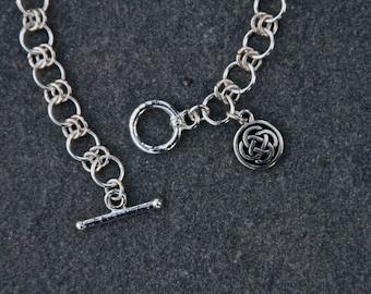 Silver Celtic Bracelet with Enclosed Celtic Knot Charm