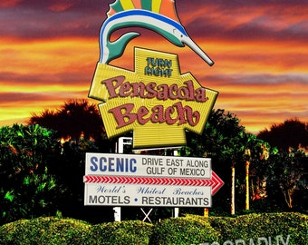 The iconic Pensacola Beach sign at sunset.