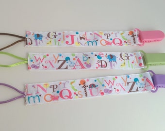 Universal alphabet animals pacifier clip, toy holder with plastic clip. Free US shipping!