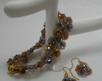 Hand made beadwiving tennis bracelet swarovski orange and purple beads