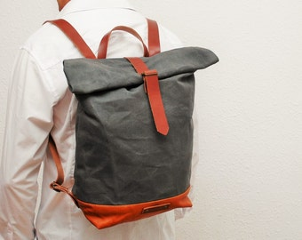 waxed Canvas rucksack/backpack, charcoal grey color, hand waxed , with handles, leather base and closures