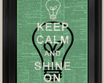 "Keep Calm and Shine On - Lightbulb print on page. Vintage book page art print. Print on book page. Fits 8""x10"" frame."