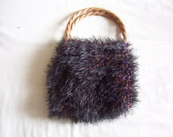 Small hand knitted handbag. Knitted purse. Black, multi-coloured wool.