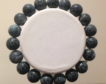 Bracelet.18cm. Features 10mm round Black Frost Obsidian Gemstone beads.