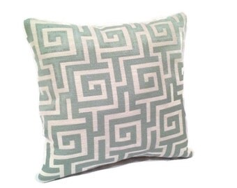 Teal and white Decorative throw pillow with greek key square pattern