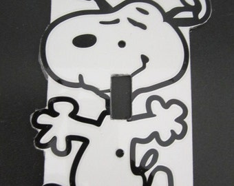 Light switch cover plate with Snoopy design.