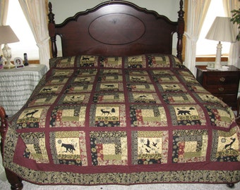 Queen or King size quilt with lots of wildlife. Definitly a mans choice. Its called the Montana Bear.