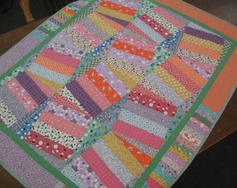 Free shipping in the U.S. for this fun and colorful Wonky 30's Baby Quilt