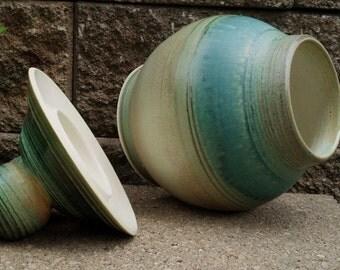Lidded jar with large handle/knob.