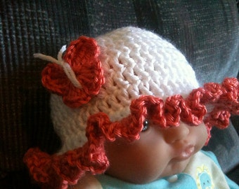crochet baby hat with ruffles and butterfly