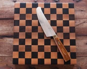 End grain cutting board in a checkerboard pattern