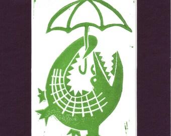 Alligator Holding and Umbrella