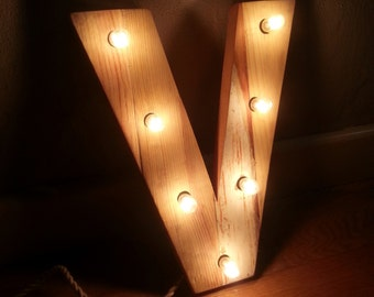 recycled wood letter with lights